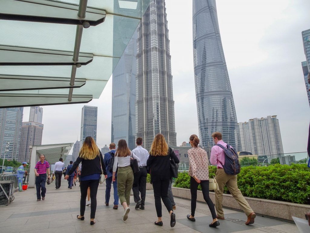 Interns walking through Lujiazui in Shanghai enroute to Citibank to understand how sector specific knowledge helps the company