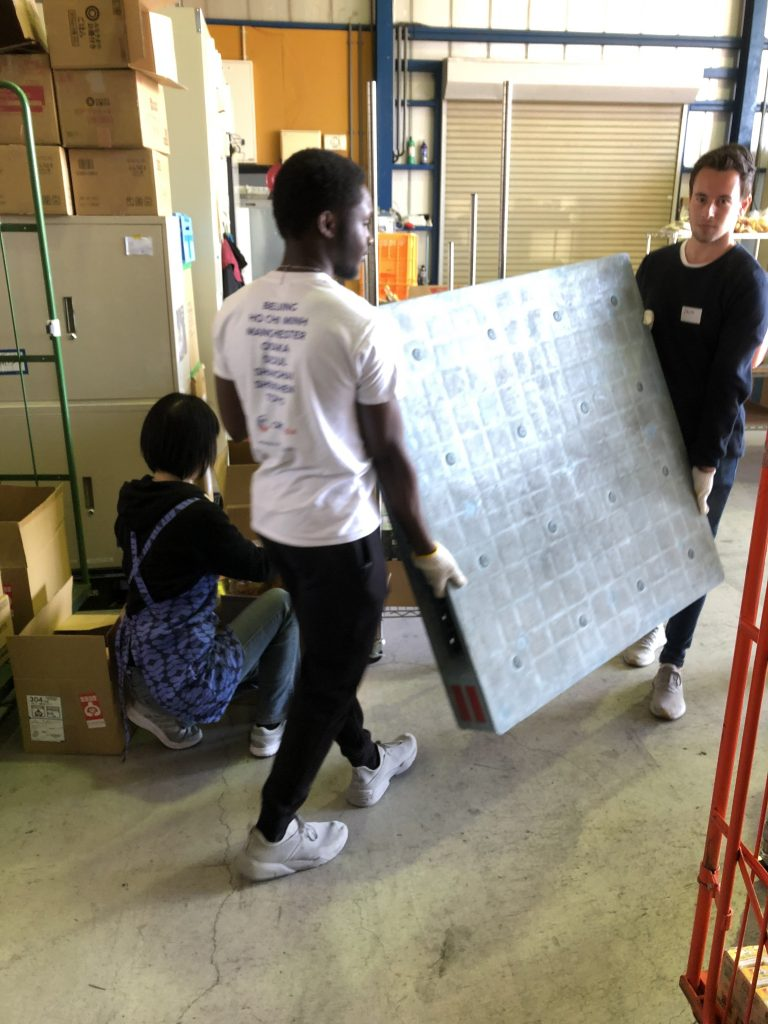 CRCC Asia interns help with Second Harvest packing