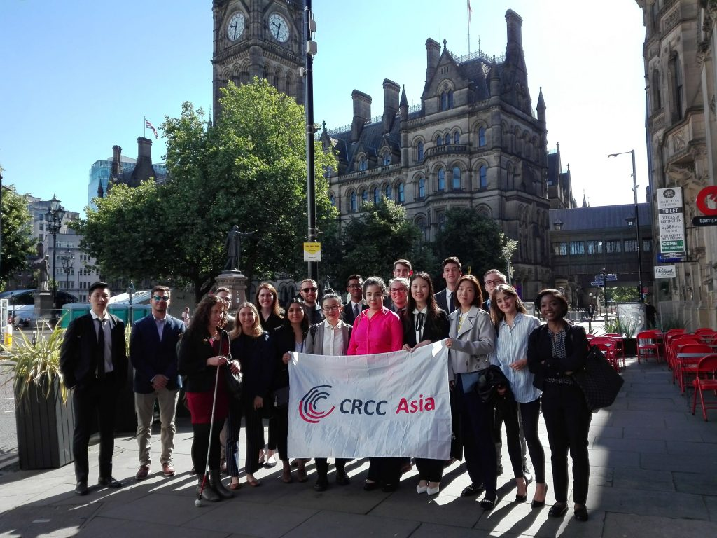 CRCC Asia interns hold the company flag in Albert Square, Manchester