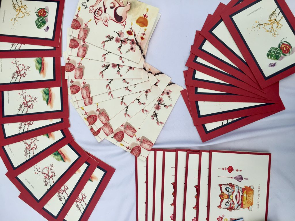The Ho Chi Minh City Team arranges the cards to be sold at the Bazaar