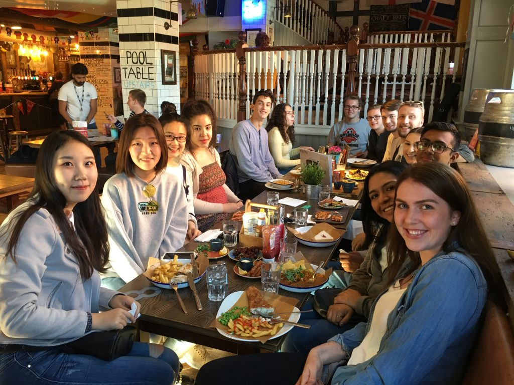 CRCC Asia interns enjoy dinner at a pub in Manchester