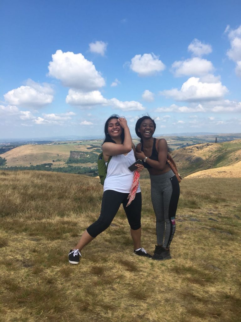 CRCC Asia interns stand on top of a hill in the Peak District