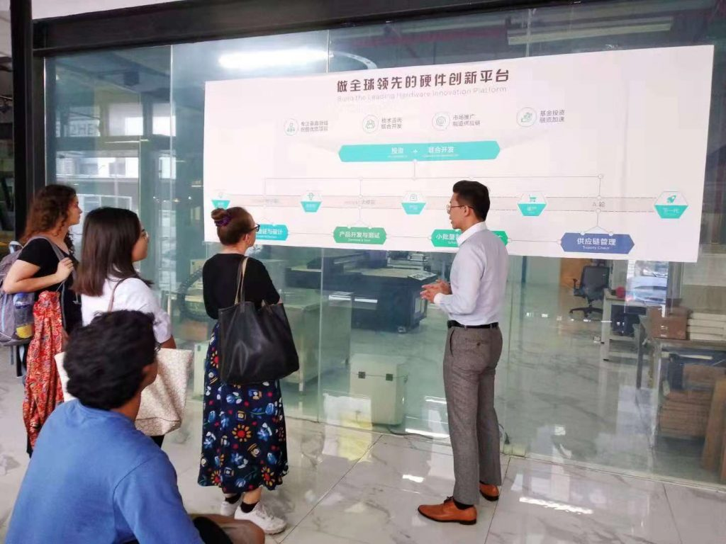 interns look at a wall chart during a company visit