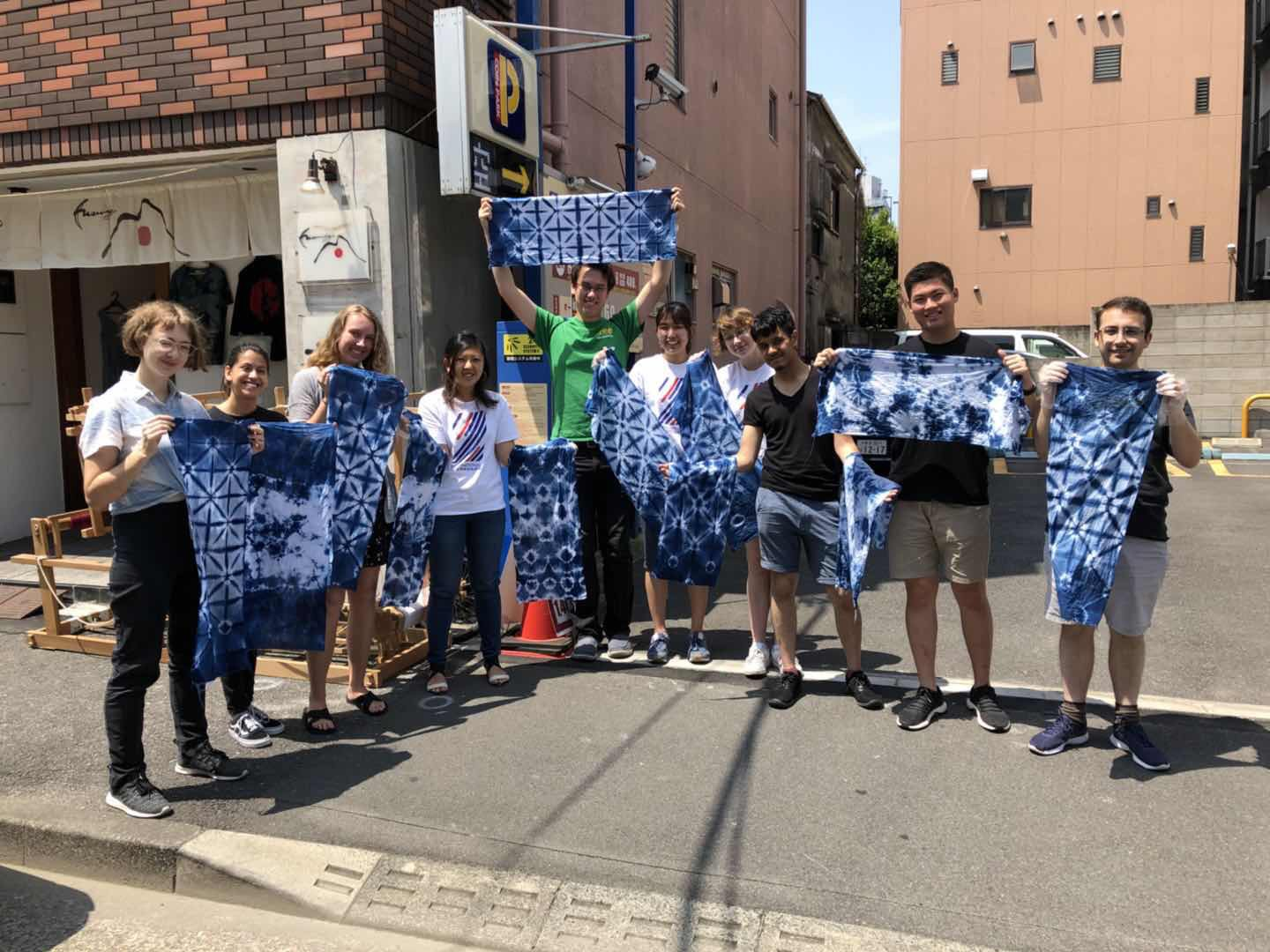 partner interns hold up japanese tie dyed cloths