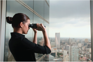 LinkedIn profile tips business person looking through binoculars