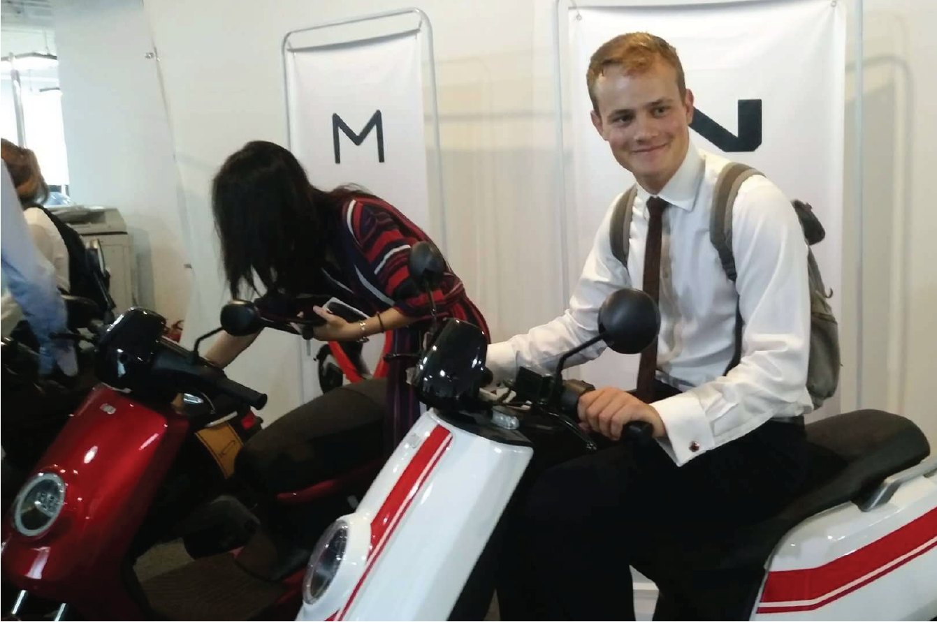 Short Term Programs Abroad student on electric bike