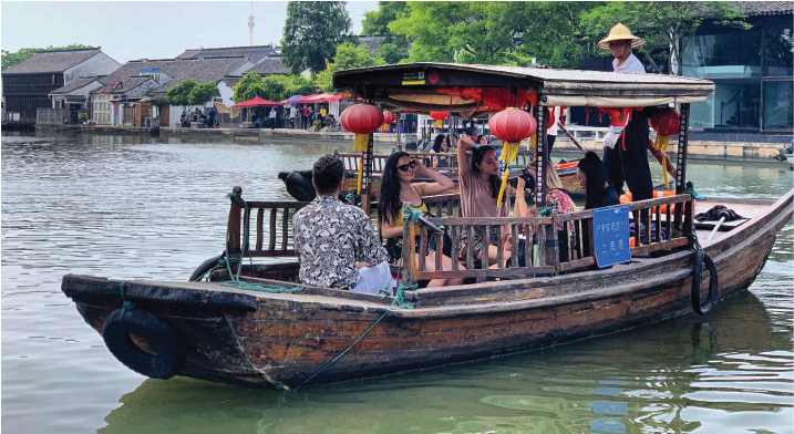 global internship program dates shanghai interns on a boat in zhujiajiao
