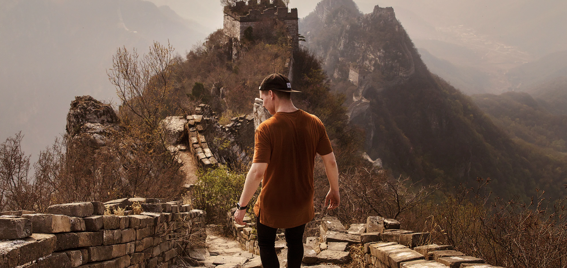 Man on the Great Wall on his Internship Abroad with CRCC Asia